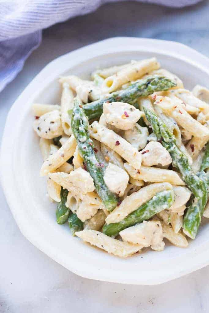 One Pan Cream Chicken and Asparagus Pasta on a plate.