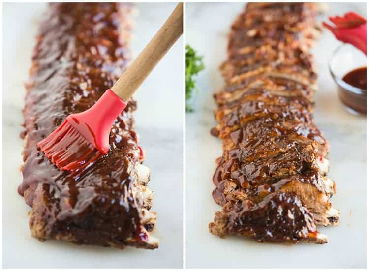 A rack of ribs brushed with bbq sauce and then cut into sections
