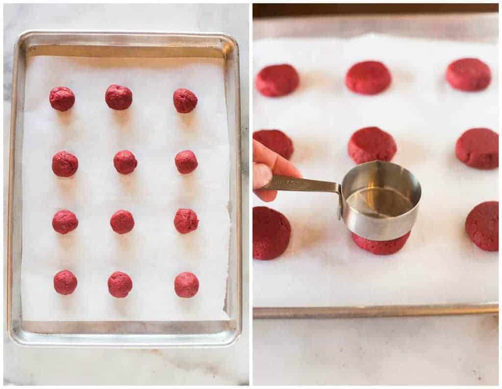 An overhead photo of a cookie sheet with balls of red velvet cookies dough, next to another photo of a cookie sheet with a measuring spoon pressing one of the cookie dough balls flat.