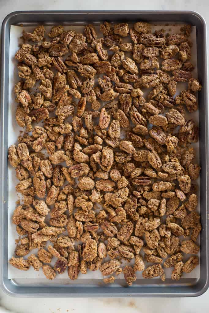 A baking sheet covered with candied pecans.