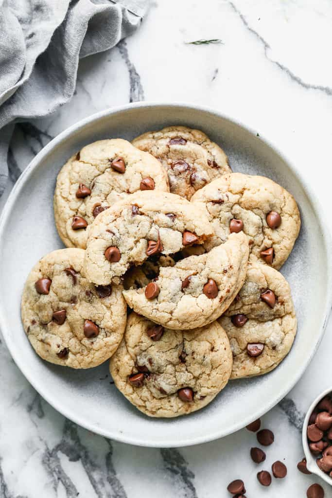 A plate of warm chocolate chip cookies.