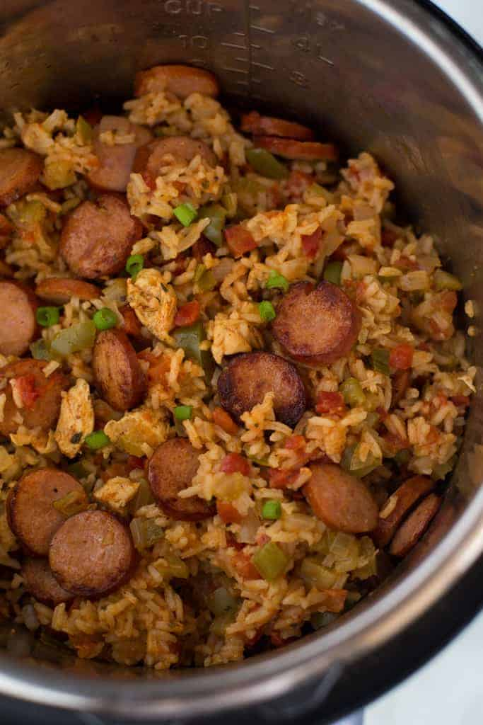Close up photo of chicken and sausage jambalaya inside of an instant pot.