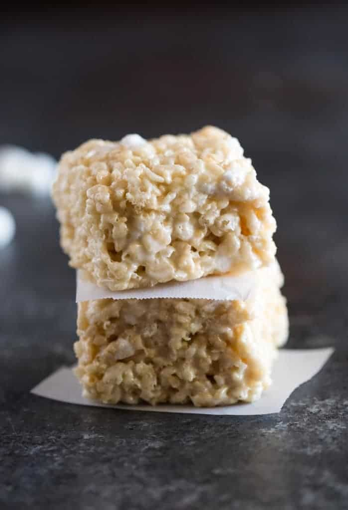 Two rice krispies treat squares stacked on top of each other.