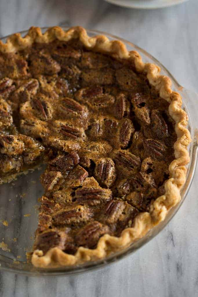 Pecan Pie with a slice taken out of it.