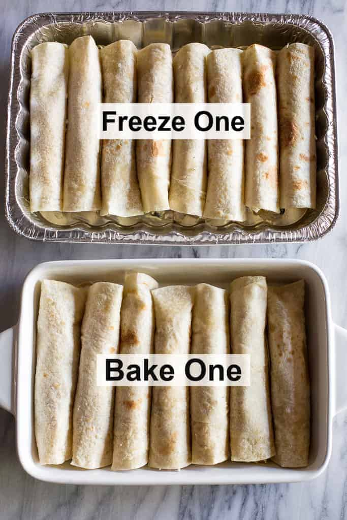 "Two 9x13'' pans of chicken enchiladas with text over both pans that says ""Freeze One"" and ""Bake One""."