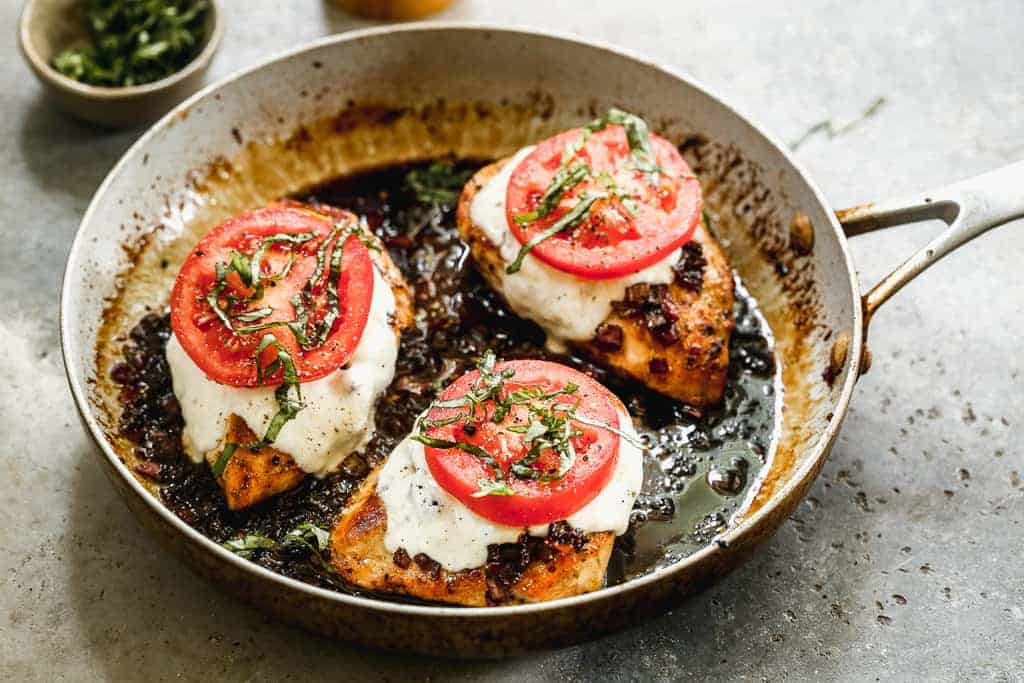 Chicken caprese in a skillet, ready to serve.