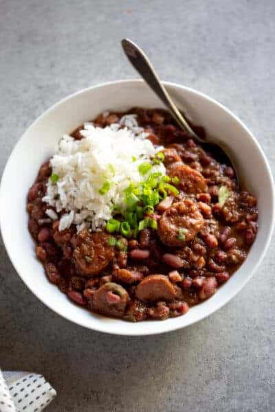 A bowl of cajun red beans and white rice that was cooked in the Instant pot.