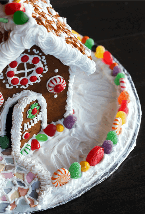 An overhead side view of a homemade gingerbread house