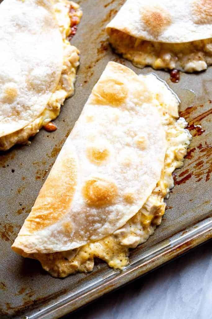 Chicken quesadilla on a baking sheet.