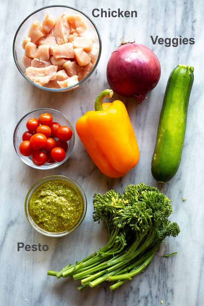 Ingredients for pesto chicken and vegetables.
