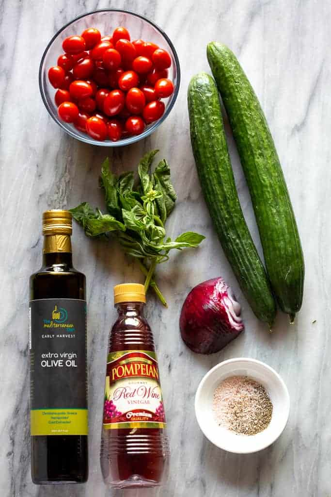 The ingredients needed for tomato cucumber salad.