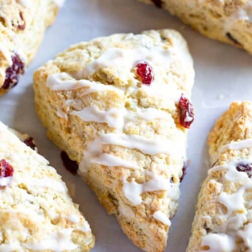 Homemade scones with dried cranberries, and glaze on top.