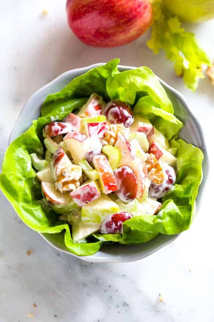 Waldorf salad in lettuce, in a bowl.