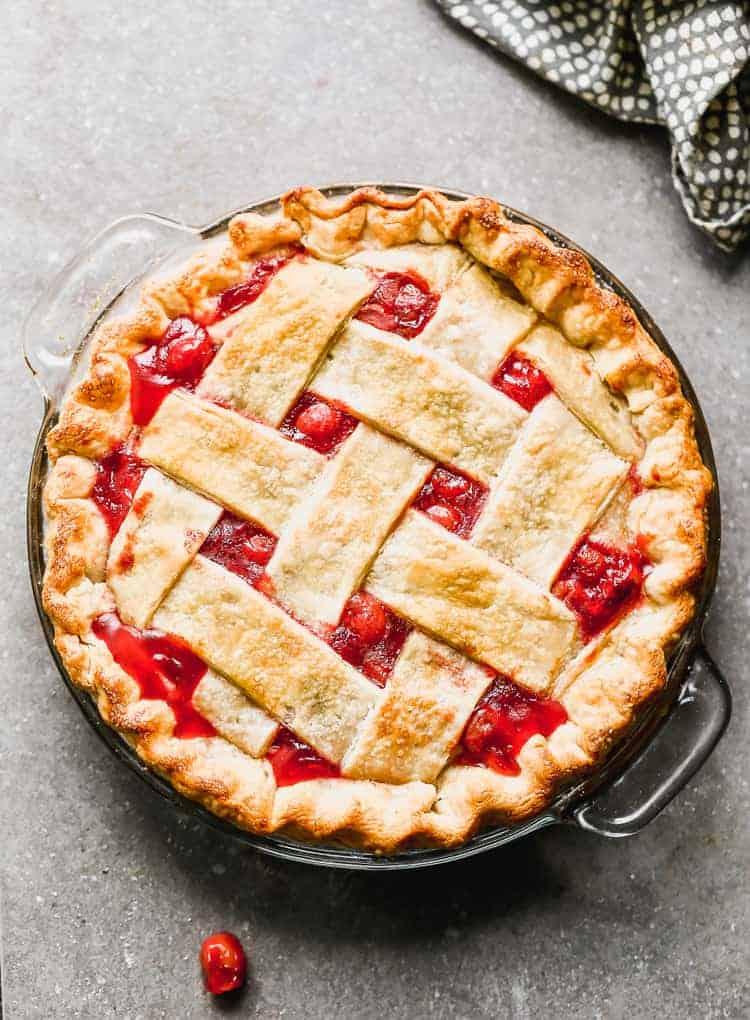 Overhead view of a baked cherry pie with lattice crust.