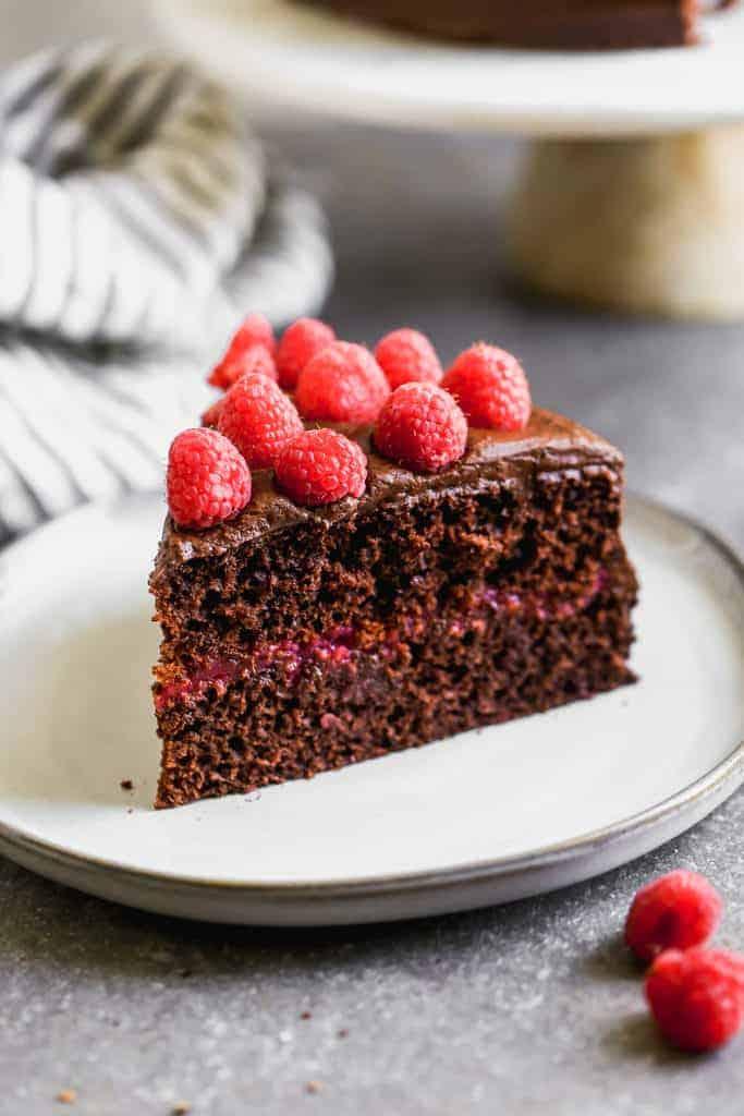A slice of Chocolate Raspberry Cake on a plate.