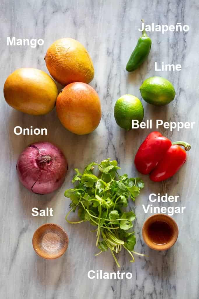 The labeled ingredients needed to make mango salsa.