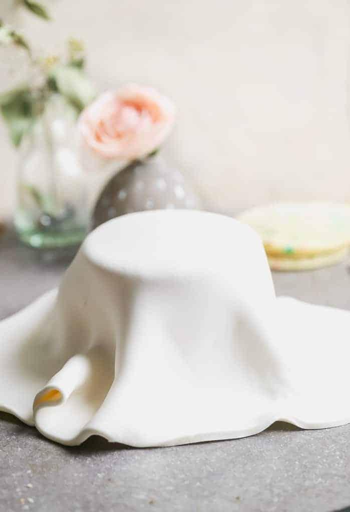 Marshmallow fondant draped over a cake.