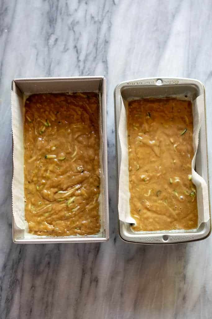 The batter for zucchini bread in to greased loaf pans, ready to go in the oven..