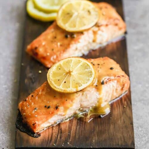 Two salmon filets cooked on a cedar plank.