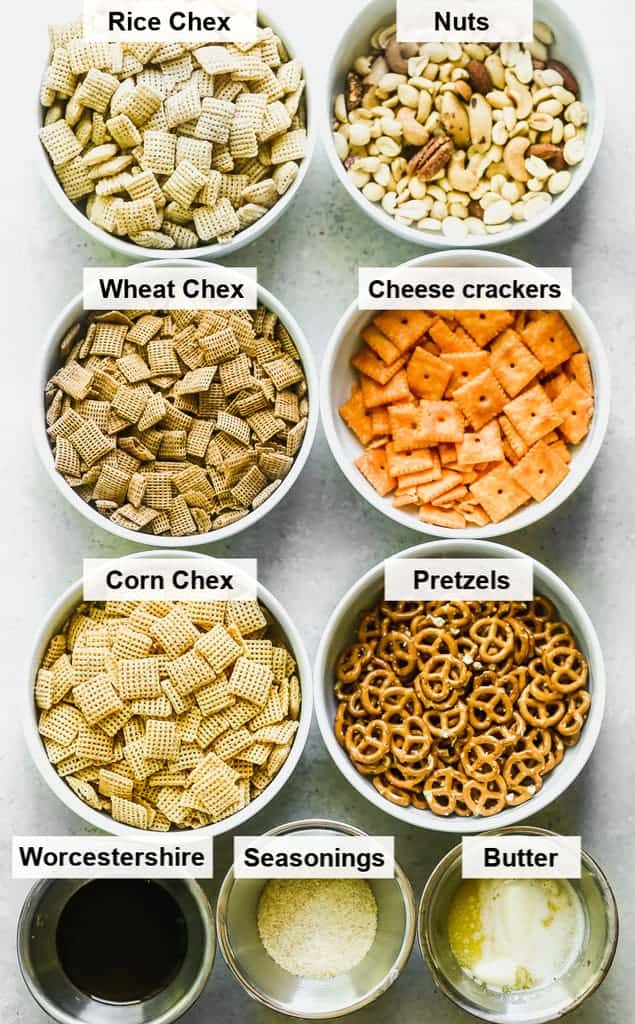 The ingredients for Chex mix in individual labeled bowls.