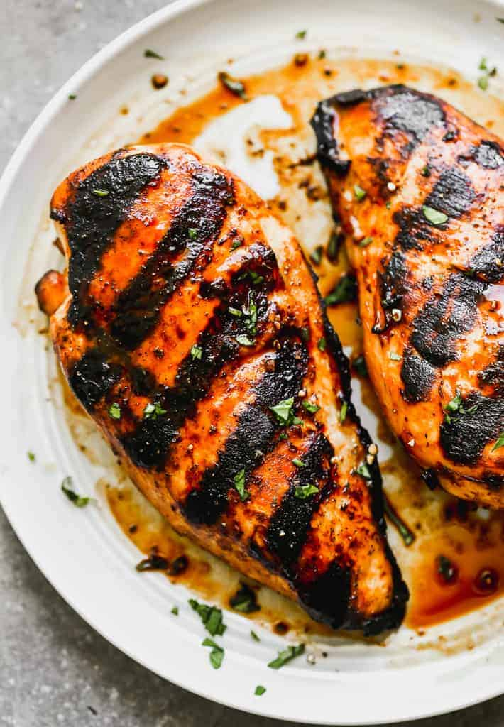 Close-up photo of a marinated, grilled chicken breast.