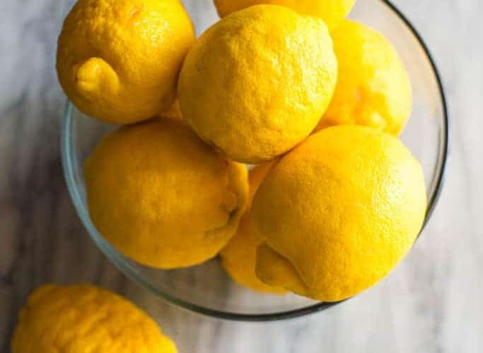 """A bowl of lemon with text overlay """"Substitutes for Lemon Juice""""."""
