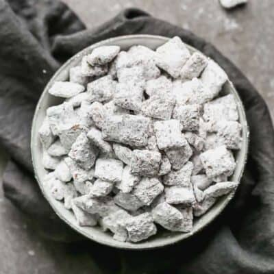 A bowl of muddy buddies (puppy chow) on a grey towel.