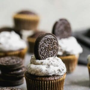 Oreo cupcakes with Oreo frosting and a whole Oreo cupcake pressed into the frosting.