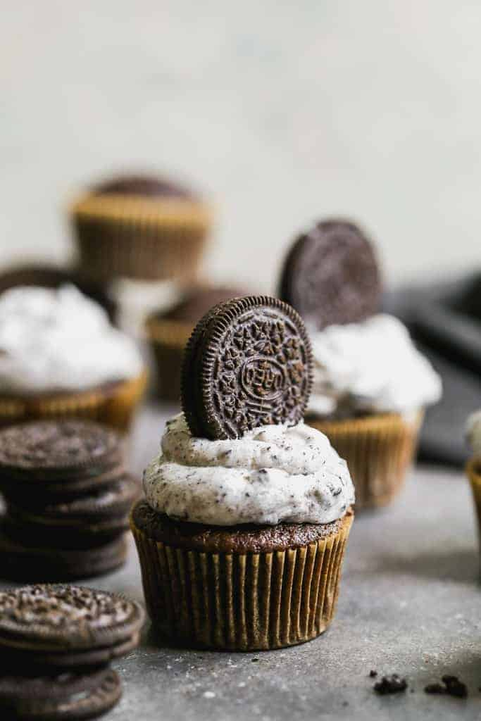Oreo cupcakes with Oreo frosting and a whole Oreo cookie pressed into the frosting.