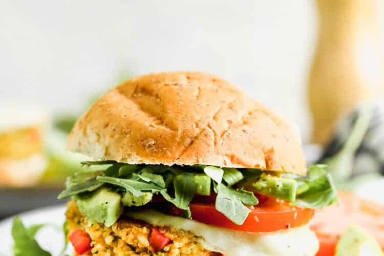 Veggie burger served on a wheat bun on a plate.