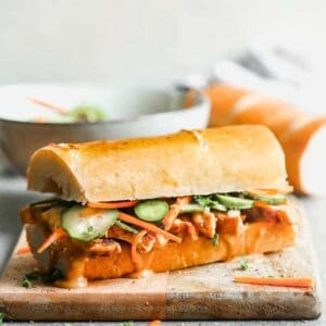 Banh mi sandwich on crusty bread, loaded with chicken, veggies and sauce.