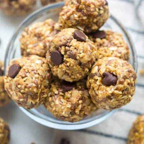 Homemade energy balls stacked on top of each other in a bowl.