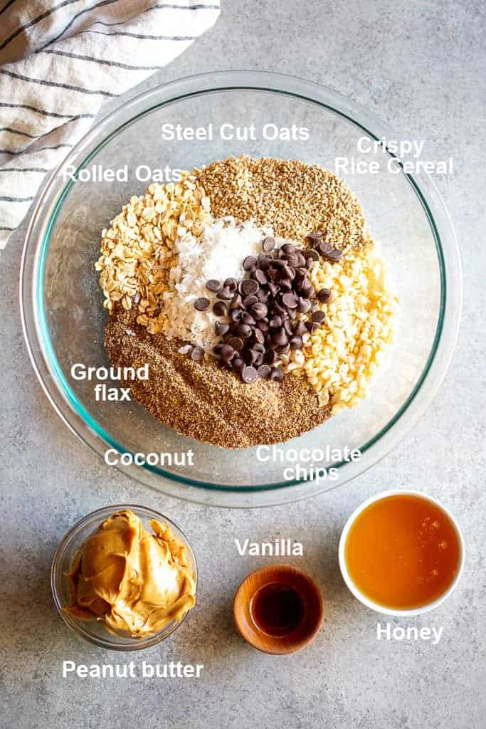 Separate bowls with the, labeled, ingredients needed to make Energy Balls.