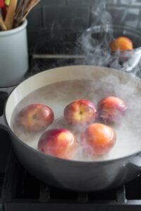 scald peaches in hot water