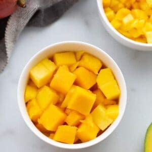 A bowl with cubed pieces of mango in it.