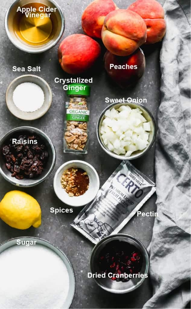 The ingredients needed for peach chutney, labeled, on a tray.