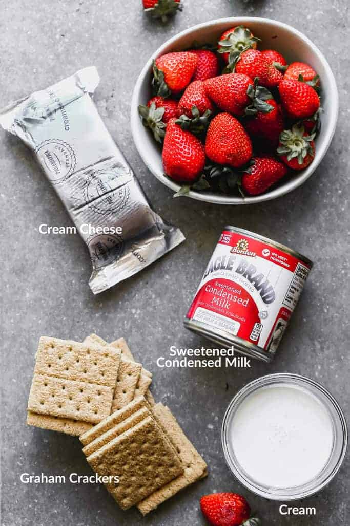 The ingredients needed to make strawberry cheesecake ice cream.