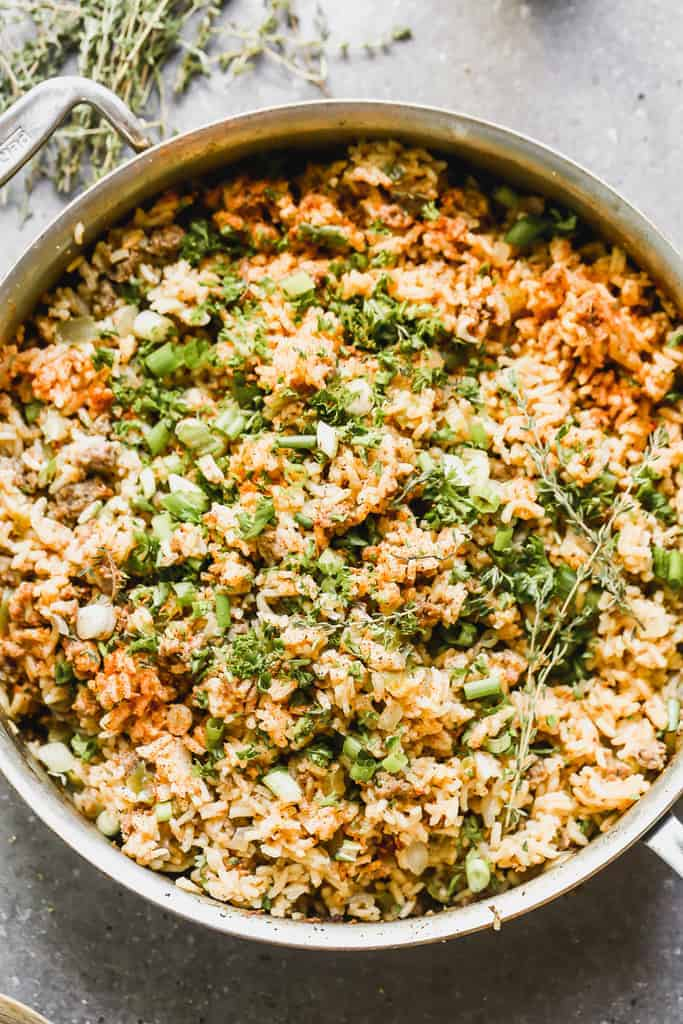 A large pot with cooked Dirty Rice in it, ready to serve.