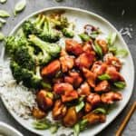 Teriyaki chicken served on a plate with white rice and steamed broccoli.