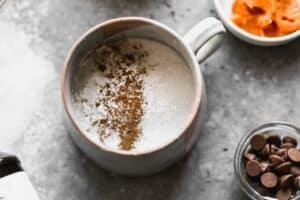 Flour, sugar, cinnamon, baking powder in a mug to make mug cake.