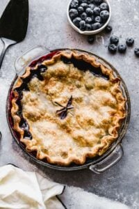 Overhead photo of a baked blueberry pie.
