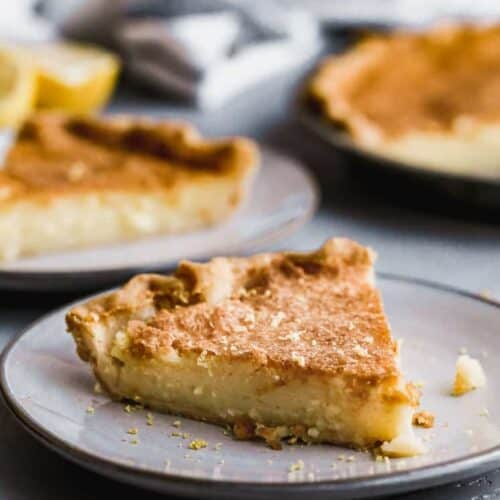 A slice of Chess Pie on a plate.