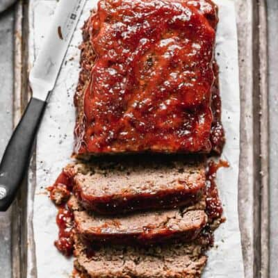 Meatloaf with meatloaf sauce on top, cut into slices.