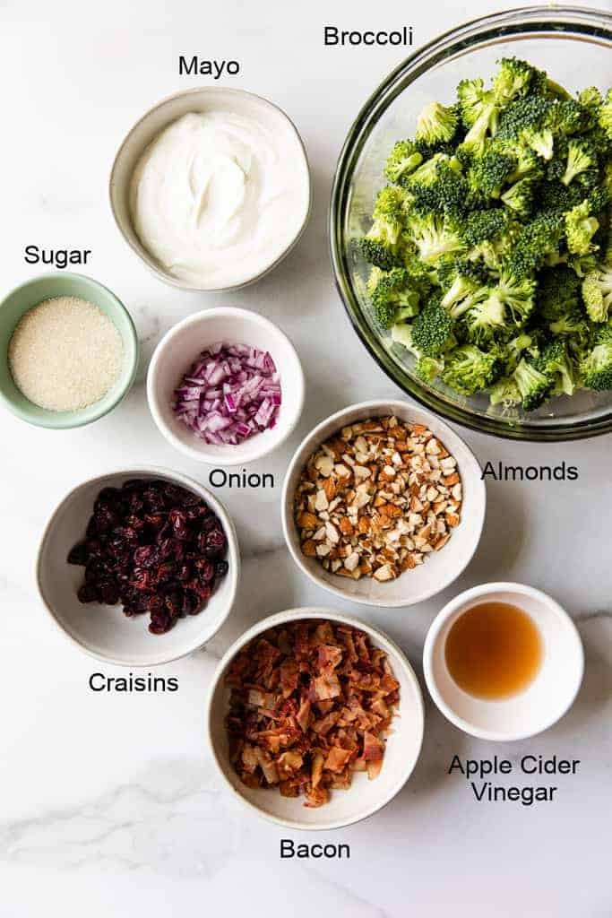 The ingredients needed for Broccoli Salad, in individual bowls.