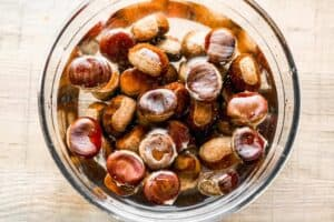 Chestnuts soaking in a bowl of water.