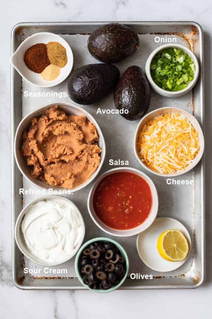 The ingredients needed to make 7-layer bean dip.