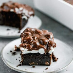 A slice of Mississippi Mud Cake on a plate.