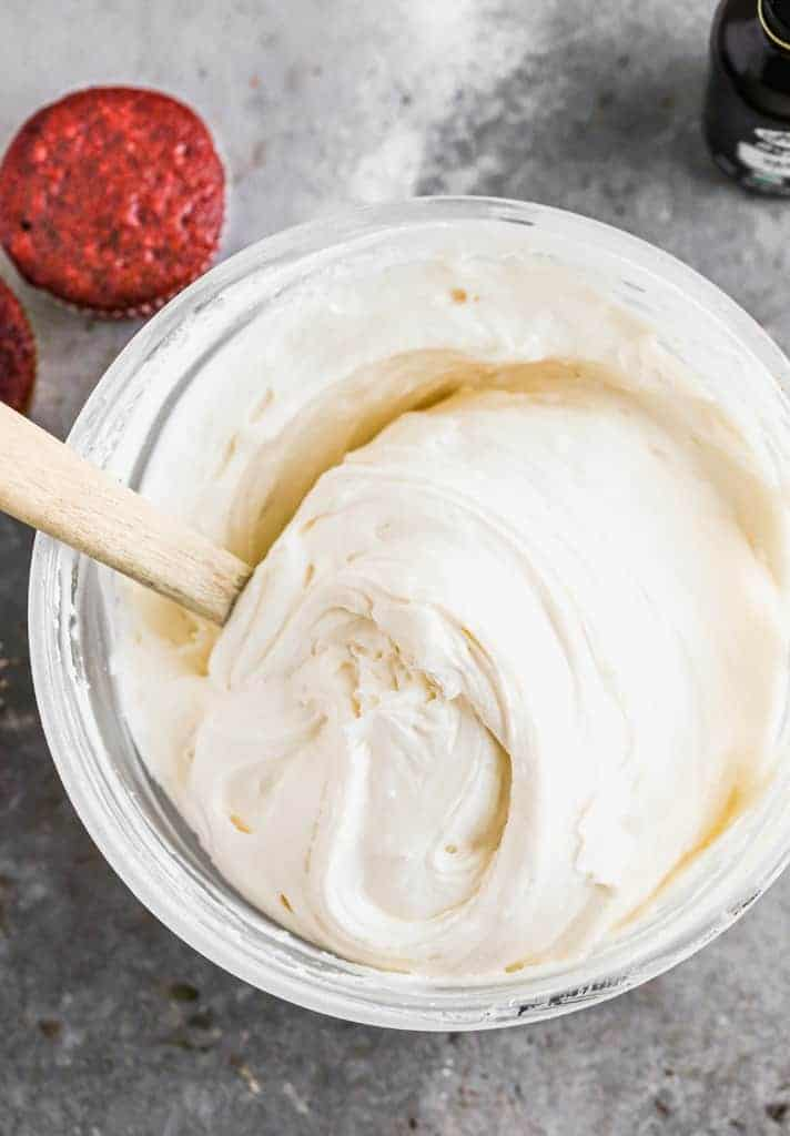 Smooth and thick cream cheese frosting in a mixing bowl, ready to be used.