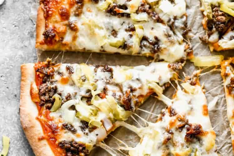 Cheeseburger Pizza baked and cut into slices.