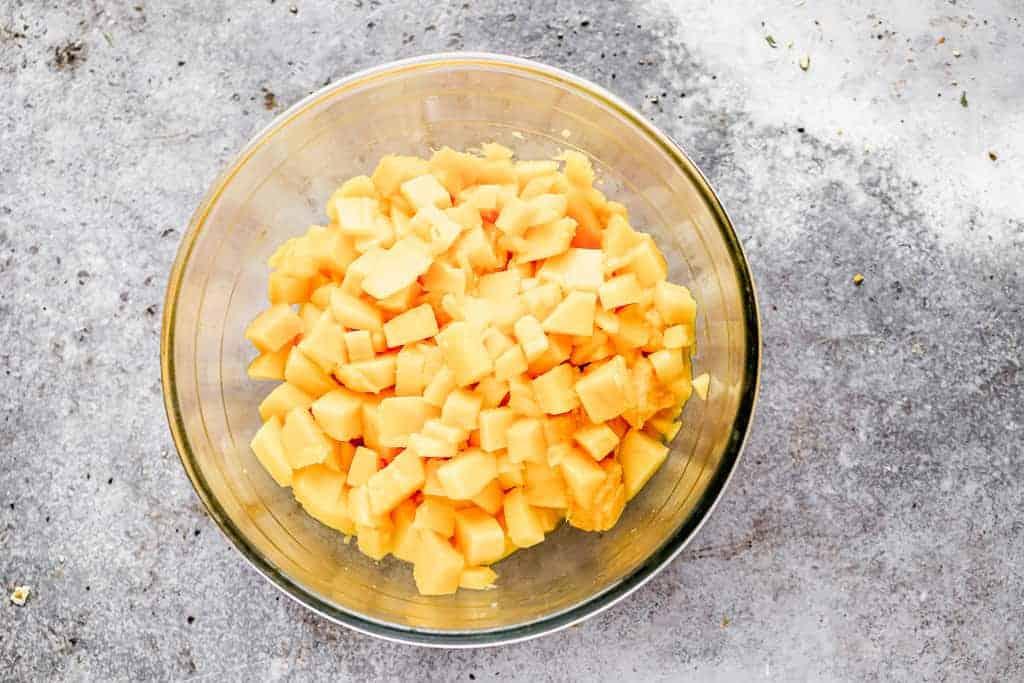 Chopped mangos in a bowl.